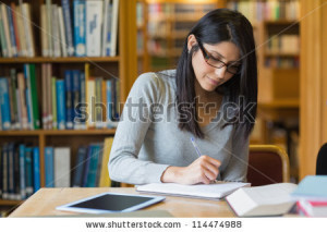 stock-photo-black-haired-woman-studying-in-the-library-114474988